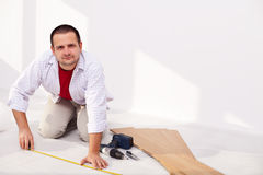 Installing laminate flooring - the isolation layer Royalty Free Stock Photo