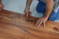 Installing laminate flooring Stock Photos