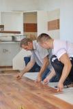 Installing laminate flooring stock images