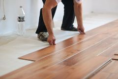 Installing laminate flooring Royalty Free Stock Photo