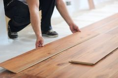 Installing laminate flooring Stock Photos