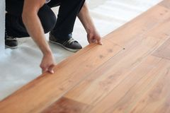 Installing laminate flooring. In new home indoor Royalty Free Stock Photography