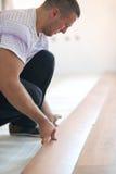 Installing laminate flooring royalty free stock photography
