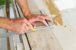 Installing laminate flooring. Royalty Free Stock Photos