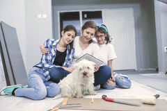 Installing laminated wooden floor Royalty Free Stock Image