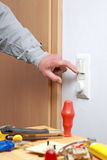 Installing a light switch. Stock Photography