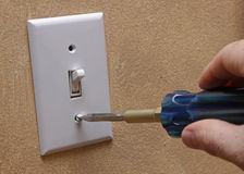 Installing Light Switch Cover Royalty Free Stock Photography