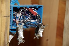 Installing Light Switch - Wiring. Lighting switch installation - new home construction stock photos