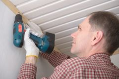 Installing molding to ceiling Royalty Free Stock Photos