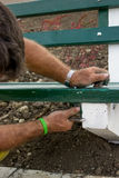 Installing new bench in the park Royalty Free Stock Image