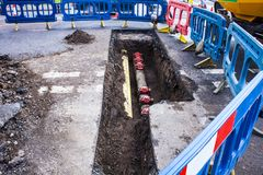 Installing new pipes in city street, mainstence work, stock images