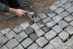 Installing pavers Royalty Free Stock Photography