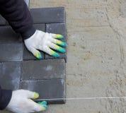 Installing paving slabs Royalty Free Stock Image