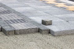 Installing pedestrian path with paver bricks Royalty Free Stock Photography