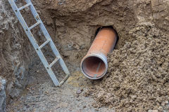 Installing pipes under the road. Sewer pipe royalty free stock photos