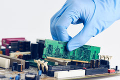 Installing In Place Computer RAM Memory Chip Stock Photos