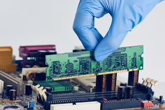 Installing In Place Computer RAM Memory Chip Royalty Free Stock Photos
