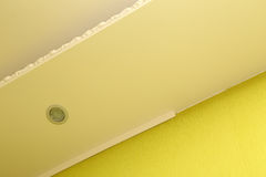 Installing plastic molding to ceiling and wall Royalty Free Stock Photo