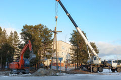 Installing a power pole with the use of special equipment Stock Photography