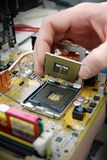 Installing processor Stock Photo