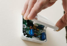 Installing a programmable room thermostat. Royalty Free Stock Images