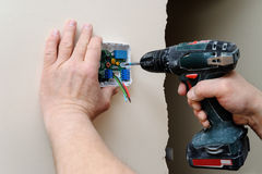 Installing a programmable room thermostat. Stock Image