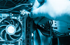 Installing RAM into the motherboard Stock Image