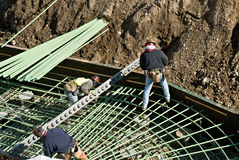 Installing Rebar in Foundation Stock Image