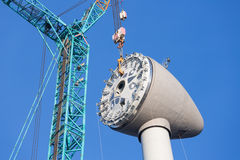 Installing rotor house at the top of a new Dutch wind turbine Stock Photos