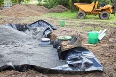 Installing the sand filter on a septic tank showing the liner , Stock Image