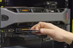 Installing server. A technician install a 2 unit rack server in a data center royalty free stock photo