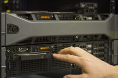 Installing server. A technician install a 2 unit rack server in a data center royalty free stock image