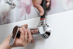 Installing a shower faucet. stock photography