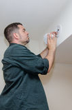 Installing smoke alarm Stock Images