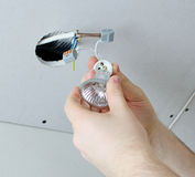Installing of socket for light bulb Stock Images
