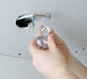 Installing of socket for light bulb Stock Images