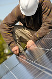 Installing Solar Panel Wiring. Installing and Connecting Photovoltaic Solar Panels on Residential Roof Royalty Free Stock Images