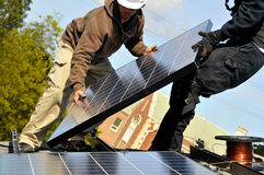 Installing Solar Panels. Installing Photovoltaic Solar Panels on Residential Roof Stock Photography