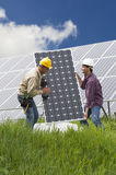 Installing Solar Panels. Technicians installing solar panels, low angle view Royalty Free Stock Image