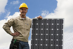 Installing Solar Panels. Technician with a solar panel Stock Photos