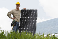 Installing Solar Panels. Technician holding a solar panel Royalty Free Stock Images