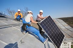 Free Installing Solar Photovoltaic Panel System On Roof Of House Stock Images - 145742654