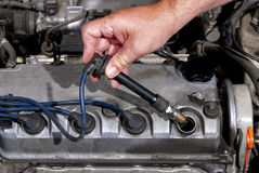 Installing a sparkplug in an automobile Royalty Free Stock Photography