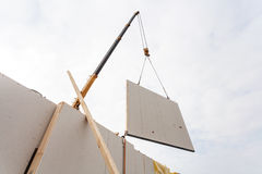 Installing structural Insulated Panels SIP. Building new frame energy-efficient house. Royalty Free Stock Photo