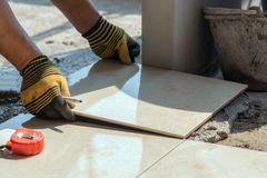 Installing tiles floor royalty free stock photography