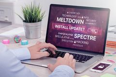 Installing update against meltdown and spectre threat on laptop in office space. Installing update against Meltdown and Spectre vulnerability on laptop Royalty Free Stock Image