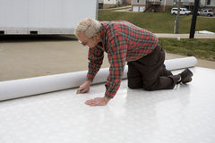 Installing vinyl flooring Royalty Free Stock Image