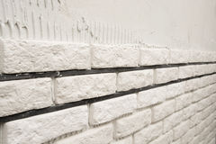 Installing white decorative bricks Stock Images
