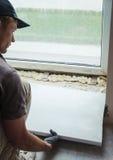 Installing window sill Stock Photo