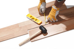 Installing wooden floor. With a gloves Stock Photos